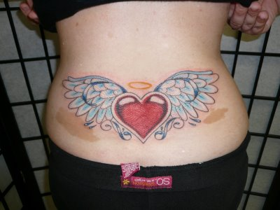 A large tribal angel wings tattoo sample for men and women.