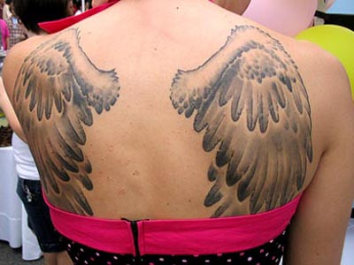 pictures of angel wings tattoos on small of back cross tattoos pictures. Black Bedroom Furniture Sets. Home Design Ideas